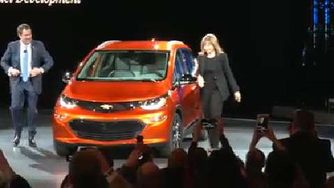 GM Chairman and CEO Mary Barra and Executive Vice President Mark Reuss unveil the all-electric Chevy Bolt at the 2016 Detroit auto show.