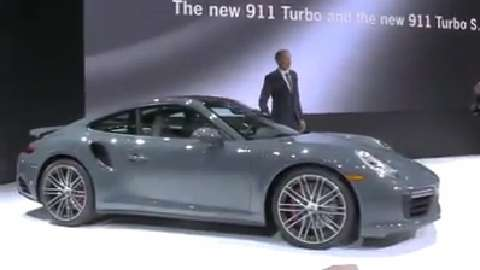 Oliver Blume, CEO of Porsche AG,  unveils the new Porsche 911 and 911 Turbo.