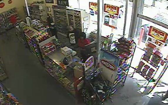Surveillance video of armed robbery at Family Dollar