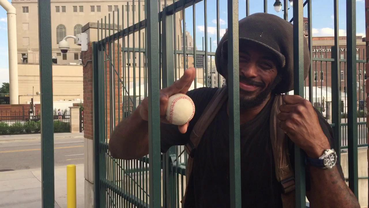 Tigers fan Cory Kinney explains how he retrieved Miguel Cabrera's home-run ball on Adams Street on Monday night.