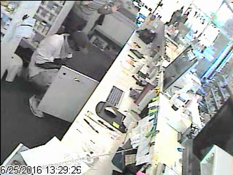 Armed robber threatens Dearborn pharmacy employees