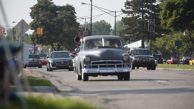 Motorists show off their cars along the avenue in Birmingham during the 2016 Woodward Dream Cruise
