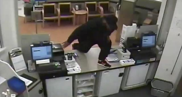 Surveillance video  of robbery suspect at Rite Aid