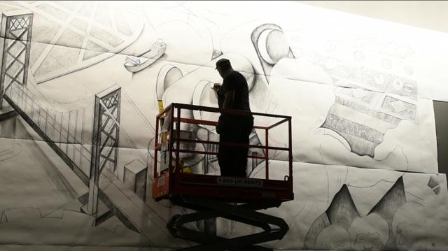 Artist creates large mural about Detroit at Cobo