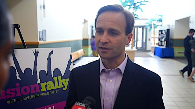 """Lt. Gov. Brian Calley signs special education legislation at """"inclusion rally"""" with advocates."""