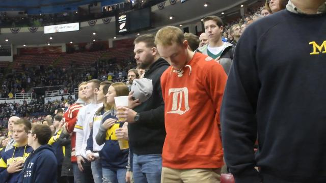 College hockey fans paused for a moment of silence honoring Mike Ilitch, Detroit business giant, Little Caesars Pizza founder and owner of the Tigers and Red Wings. News of Ilitch's death had been announced just hours earlier.