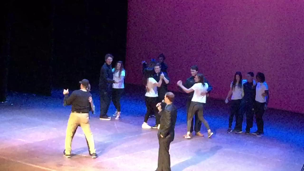 Harbaugh and wife Sarah dancing while being serenaded by the baseball team during Mock Rock.