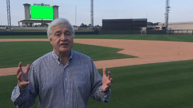Lynn Henning of The Detroit News shows off the new-look Joker Marchant Stadium in Lakeland, Florida.