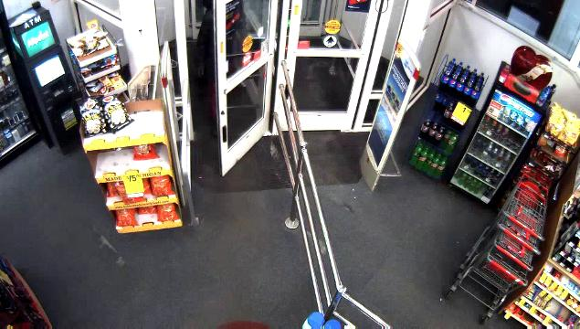 Surveillance footage released Tuesday shows a masked man in dark clothing using a gun to force a manager back into the store in the 10000 block of West McNichols at about 5 a.m. Feb. 8.
