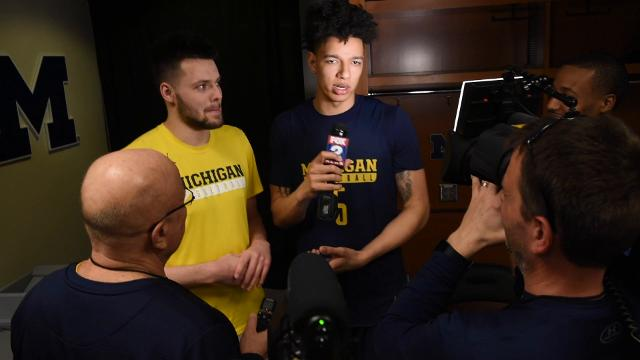 Michigan teammates keep the mood light in the locker room by talking haircuts and hair styles.
