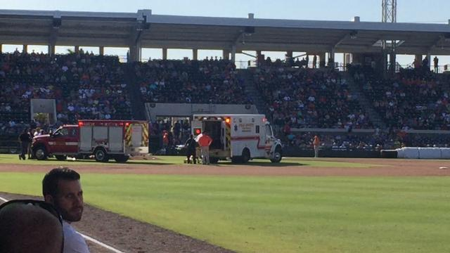 Blue Jays pitcher T.J. House is lifted into an ambulance after being struck in the back of his head by a line drive by the Tigers' John Hicks.