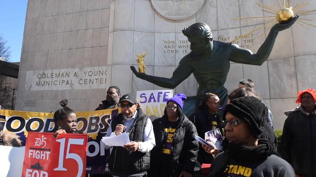Approximately 100 SEIU Local 1 members and supporters, security guards and Detroit City Council members attend the Stand for Security rally in front of the Spirit of Detroit, Wednesday, March 29, 2017.