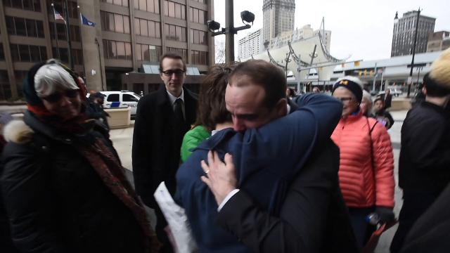 An emotional crowd outside the McNamara Federal Building in Detroit reacts to news that an Ann Arbor father of four was granted a rare deportation waiver on Tuesday, February 28, 2017.