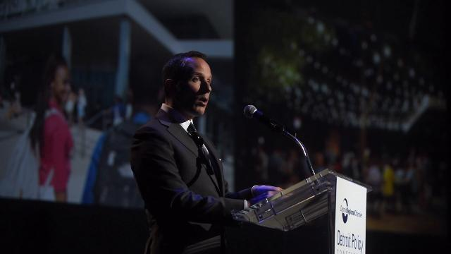 President and CEO of Ilitch Holdings Christopher Ilitch praises the public and private partnership that's creating the massive District Detroit during the Detroit Policy Conference at the Motor City Casino on March 2, 2017.