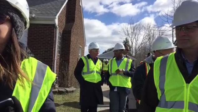 Michigan Gov. Rick Snyder visits a Dearborn Heights neighborhood with uprooted trees and power outages.