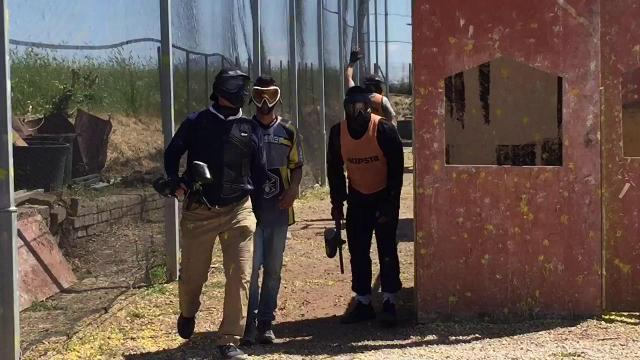 Jim Harbaugh takes shot at paintball in Rome