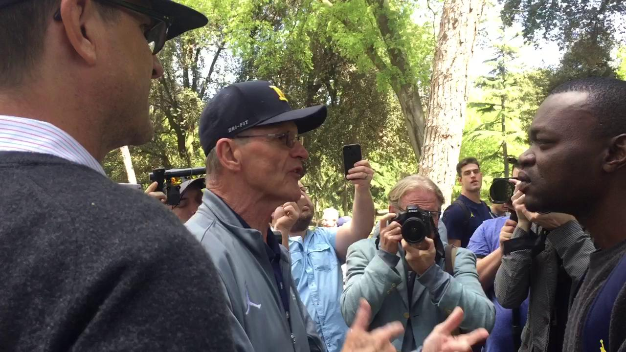 Jim Harbaugh called in the heavy reinforcements (his father Jack) to explain football to the refugees at the Borghese Gardens.