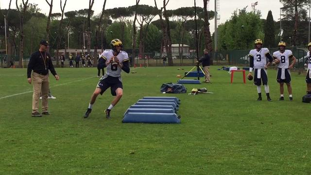 Jim Harbaugh oversees quarterback drill