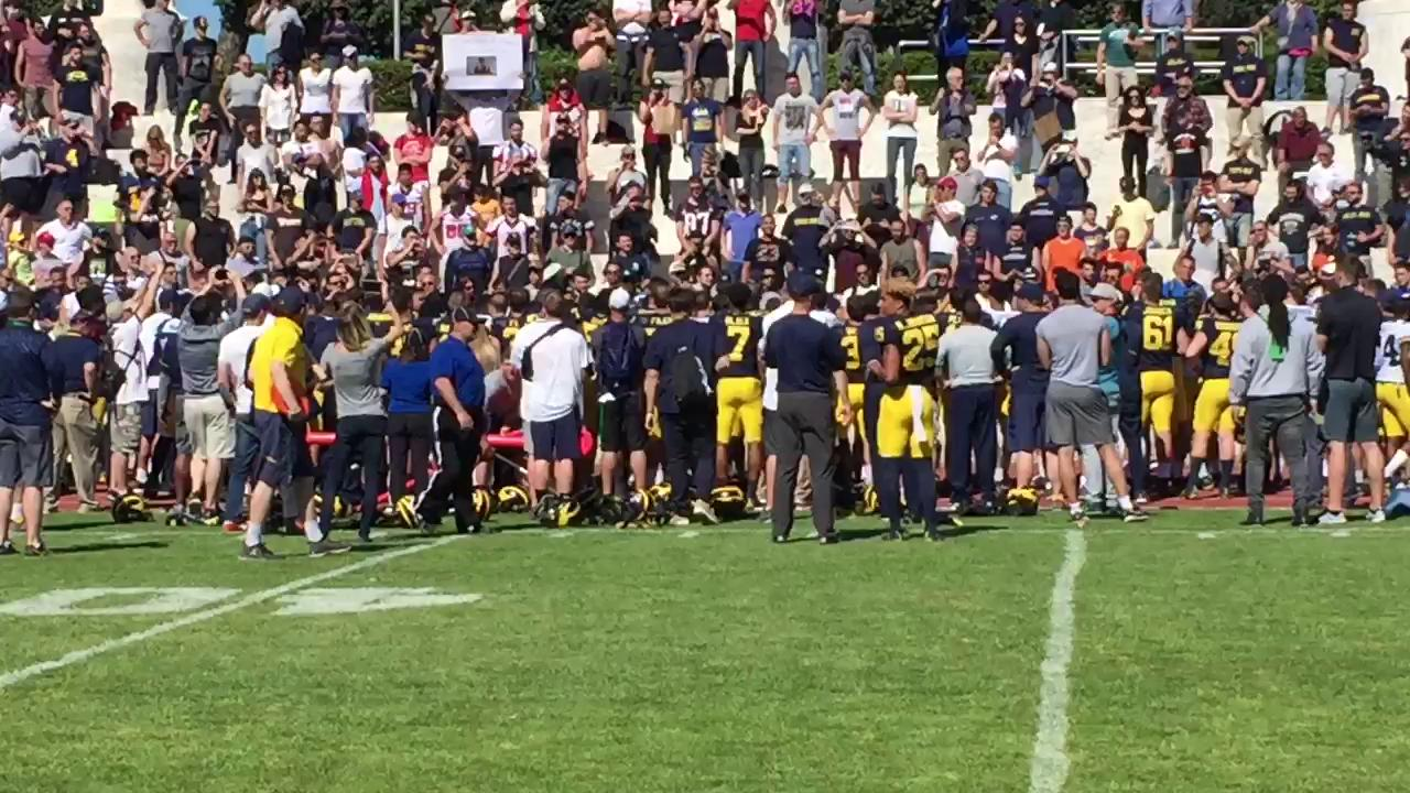 "Arrivederci Roma! Michigan players sing ""The Victors"" for fans at the conclusion of their final spring practice."
