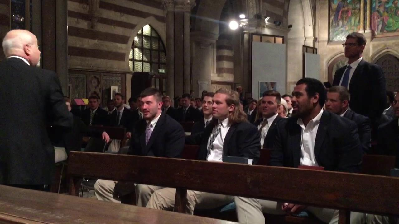 Michigan coach Jim Harbaugh asks the tenor for a motivating aria when the team took in an opera performance at St. Paul's Within the Walls in Rome on Thursday night.