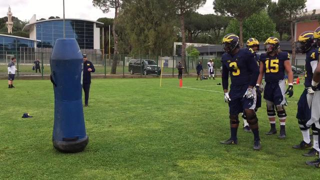 UM Don Brown instructs defensive linemen