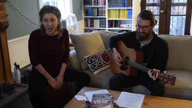 """Detroit Jews for Justice Rabbi Alana Alpert and Jake Ehlrich recording a revised, activist-inspired version of the Passover Seder song """"Dayenu""""."""