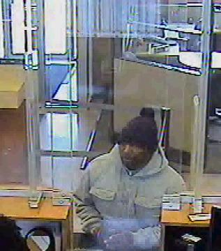Police are looking for a black male suspect who entered Comerica Bank on Telegraph Road in Dearborn on April 4. He pointed a handgun at the teller, then fled without receiving any money.
