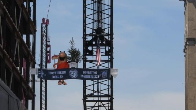 Little Caesars world headquarters hosts 'topping out' ceremony
