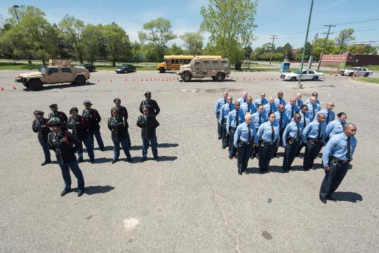 To kick off National Police Week Chandler Park Academy's JROTC and the Detroit police academy's student officers square off in a military parade contest