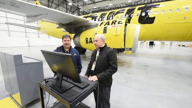 The 132,000 square foot hangar is home to 100 mechanics who can work on seven planes at a time.