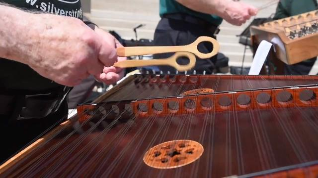 Lunchtime entertainment outside Michigan's Capitol building Tuesday featured members of the Silver Strings Dulcimer Society, based in Garden City.