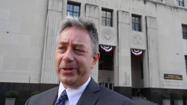 Michael J. Steinberg, legal director of the ACLU of Michigan, speaks outside of the federal courthouse in favor of  expanding the emergency hearing request on immigrant deportations to nationwide status.