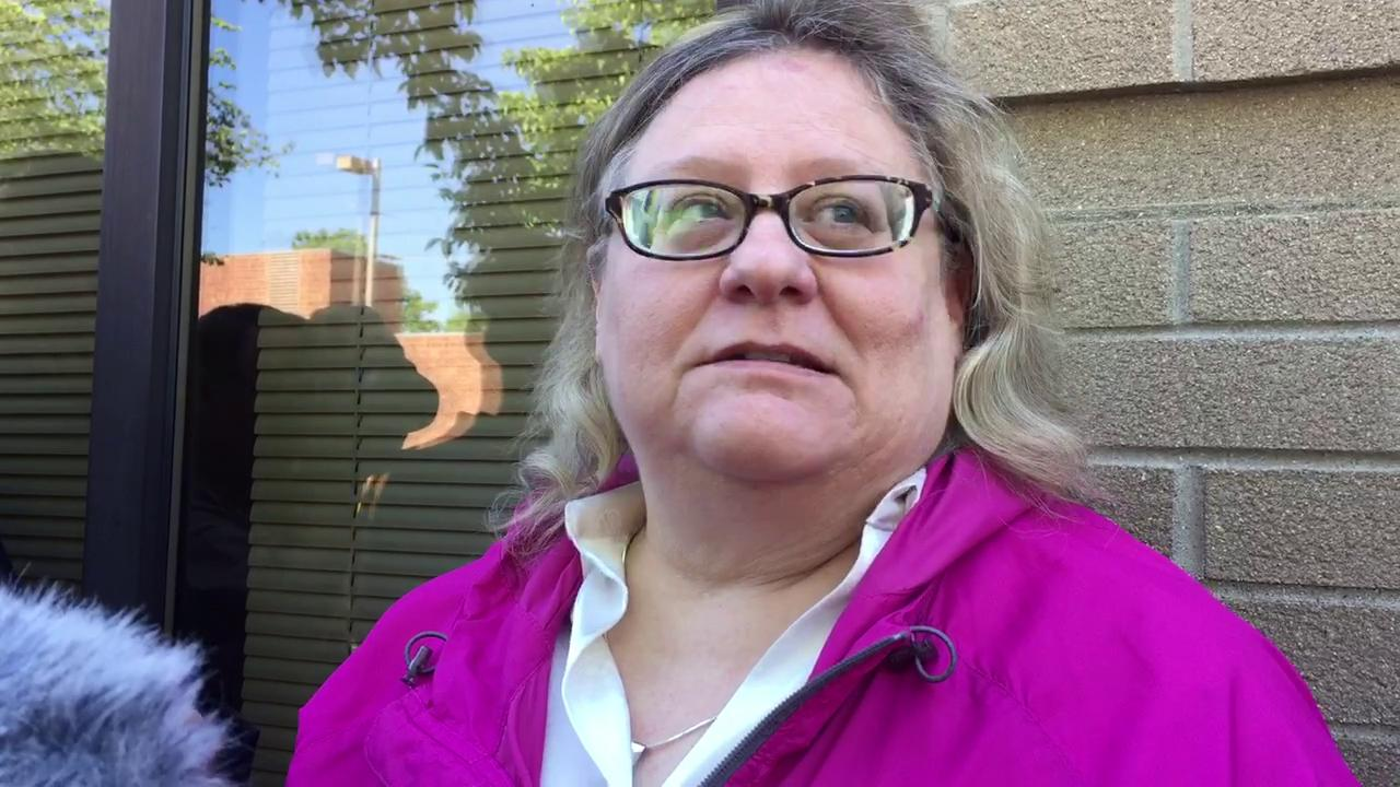 Karen Truszkowski, attorney for the alleged victim in the Michigan State football sexual assault case, speaks outside 54B District Court in East Lansing on Tuesday.