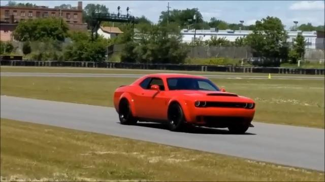 Dodge boss Tim Kuniskis demonstrates the crazy 2.3 second 0-to-60 time of the 2018 Dodge Challenger SRT Demon June 1 at the M1 Concourse in Pontiac.